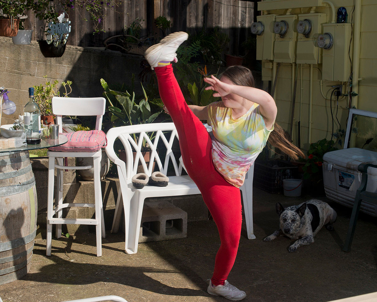 Rachel practices karate in her back yard.