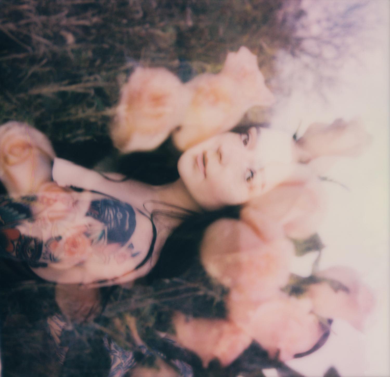 A polaroid of Emily Olin, 2020.