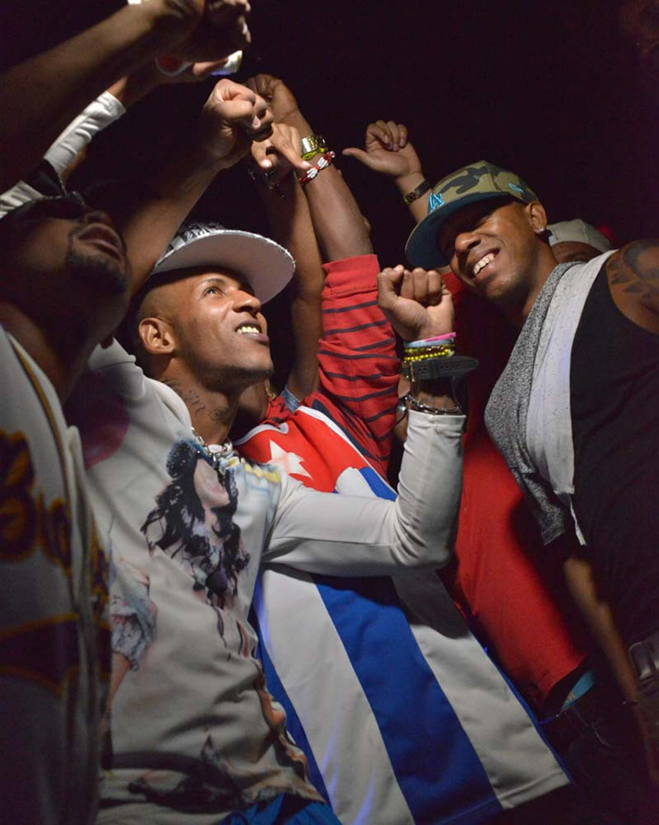 Young Cubans pose for a selfie during a rap concert at the Brindisi, a private club on the outskirts of Havana.