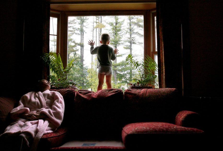 Carolynne watches EJ play in the window while Rich is gone on a business trip. Carolynne says she worries about taking EJ outside alone because she no longer has the energy to keep up with him. 2006