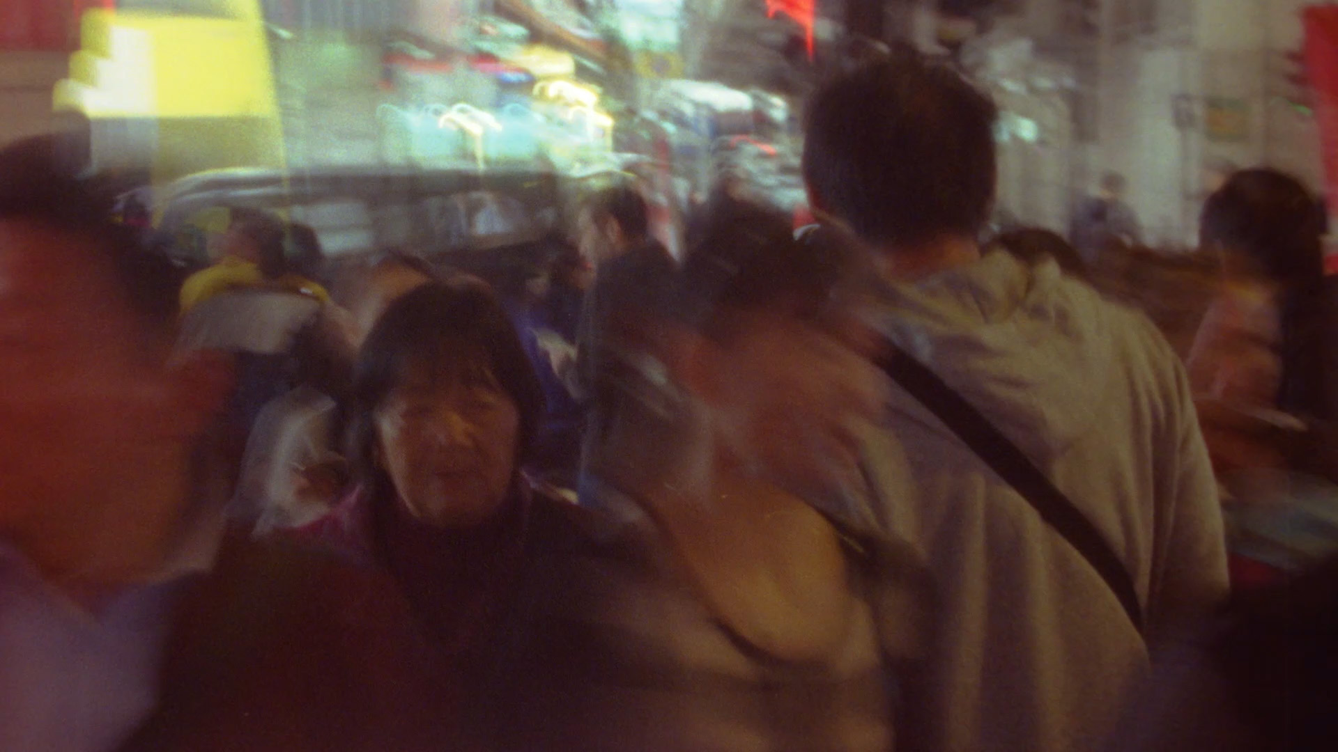 Motion blurred image of a sidewalk crowded with pedestrians from Signal 8 (2019) by Simon Liu