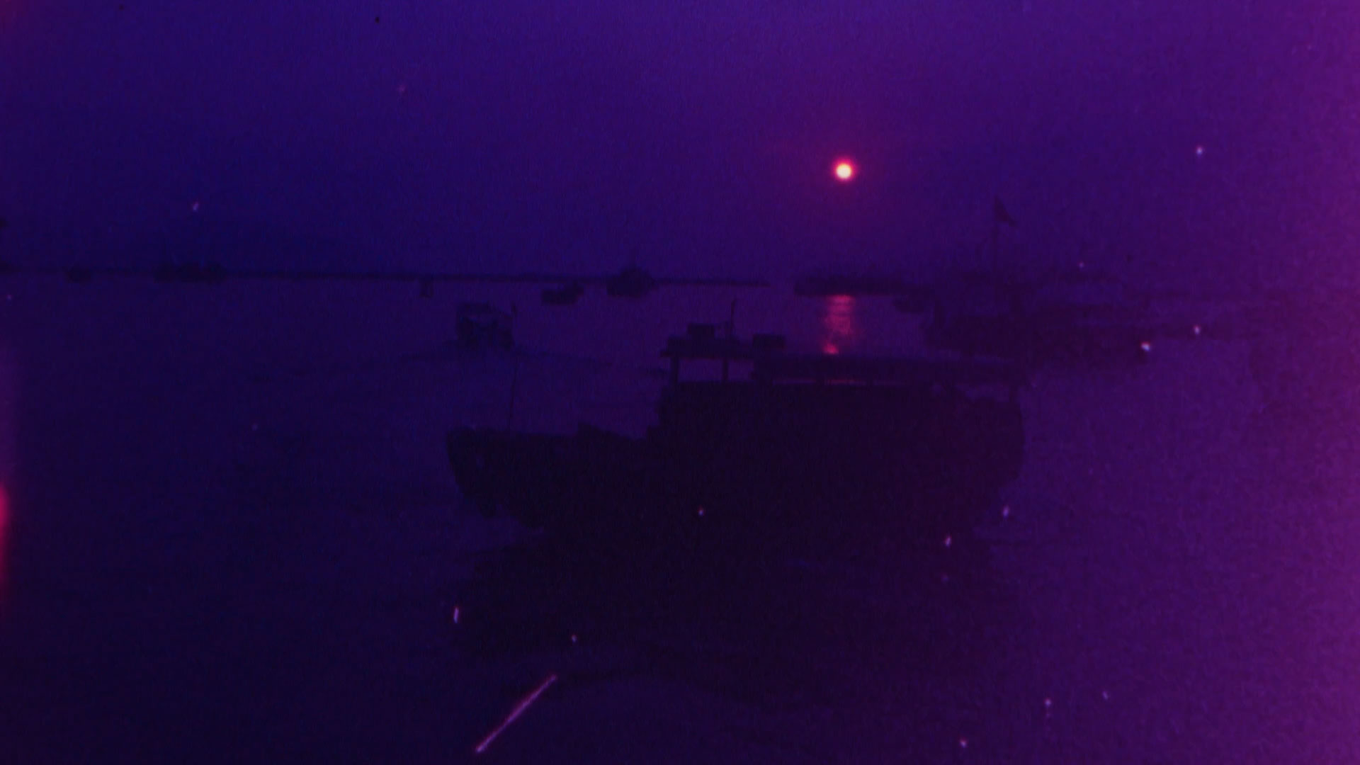 Purple tinted image of bay with boat at sunset with light leak at the edge Signal 8 (2019) by Simon Liu